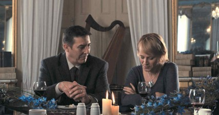 Ciaran Hinds and Iben Hjejle in The Eclipse (2010). The 'writers dinner' filmed in the Drawing Room at Fota House