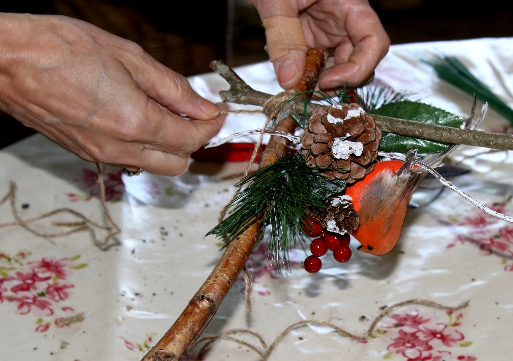 Jackie puts the final touches to a wooden decoration